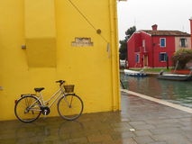 Yellow bicycle on the wall, this photo was taken in Copenhagen, Denmark. Cycling from the city's heavily used Stock Images