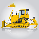 Yellow big digger builds roads. Digging of sand, coal, waste rock and gravel. Royalty Free Stock Images