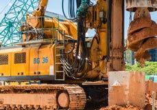 Yellow big drill machine is working. Big drill machine is working stock image