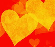 Yellow big hearts backgrounds on red backgrounds Royalty Free Stock Photo