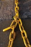Yellow big metal industrial chain in sea port royalty free stock photography