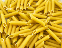 Yellow big spaghetti Stock Images