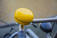 Yellow bike bell Stock Images