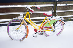 Yellow bike covered with snow. Winter time with yellow bike covered with snow Royalty Free Stock Images