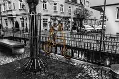 Yellow Bike on the fence Royalty Free Stock Images