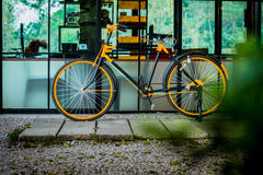 Yellow bike. The yellow bike next to the house looks beautiful and the atmosphere of the house makes the face Stock Photography