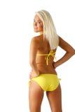 Yellow bikini. Model shows off her backside wearing a yellow bikini Royalty Free Stock Photos