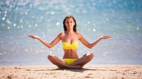 Yellow bikini yoga stock image