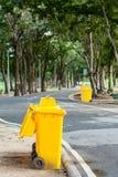 Yellow bin in park Stock Photography