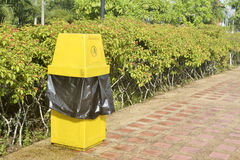 A yellow bin. Royalty Free Stock Images