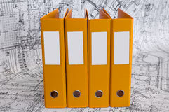 Yellow binder folders in the design drawings Stock Photography