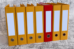 Yellow binder folders in the design drawings. Row from the yellow file folders and one red folder with clean blanks for your text. Black and white project Stock Photos