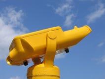 Yellow Binoculars. Public yellow binoculars against the blue summer sky Stock Photos