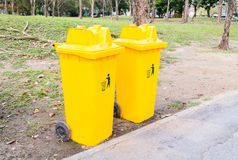 Yellow bins in the park. Royalty Free Stock Images