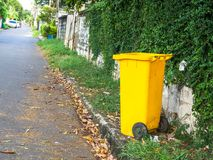 Yellow bins are placed on the side of the road in the village. Trash is for people in the village for left the garbage waiting to. Be Sorting for recycling royalty free stock photo