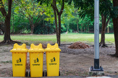 Yellow bins. Three yellow bins in the park Stock Photos