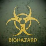 Yellow biohazard symbol on a green military background. Warning Stock Photos