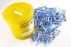 Biological waste disposal and empty glatiramer acetate syringes stock image