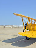 Yellow biplane at airfield Stock Image