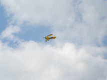 Yellow Biplane in flight Royalty Free Stock Image