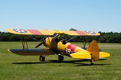 Yellow Biplane II. Antique biplane, circa 1929-30. Many of these aircraft were used to train military pilots in the 1940s. This one is painted in the color stock photos