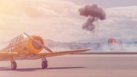 Yellow Biplane on Runway Royalty Free Stock Photo