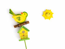 Yellow bird with birdhouse and sun Stock Photo