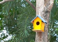 Yellow birdhouse Royalty Free Stock Photography