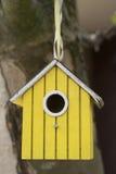 Yellow birdhouse Stock Photography