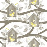 Yellow birds for bird boxes on trees Stock Image