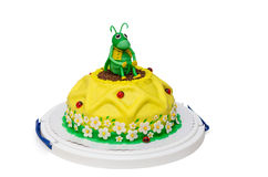 Yellow birthday cake sunflower with grasshopper Royalty Free Stock Photography