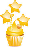 Yellow birthday cupcake Stock Image
