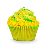 Yellow birthday cupcake with green cream Stock Photography
