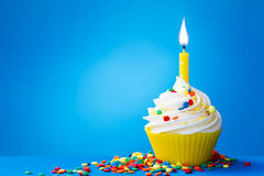 Yellow birthday cupcake stock photography