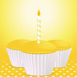 Yellow birthday cupcakes background Royalty Free Stock Image