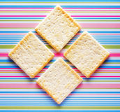 Yellow biscuits on striped background Royalty Free Stock Image