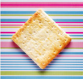 Yellow biscuits on striped background Stock Images