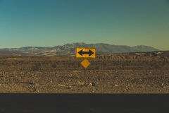 Yellow and Black Arrow Road Signage during Daytime Stock Images