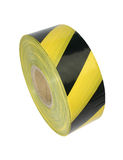 Yellow and black barrier tape. On white background Royalty Free Stock Photo