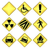 Yellow and black caution road signs Royalty Free Stock Images