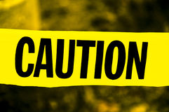 Yellow and Black Caution Tape. A picture of Yellow and Black Caution Tape in large font with blurred background royalty free stock photos