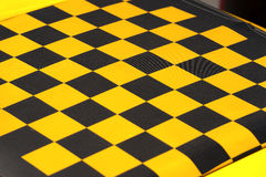 Yellow and Black Checkered Background Royalty Free Stock Photos