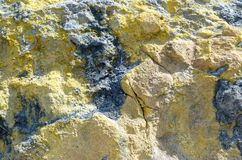 Sulfur texture, island Vulcano, Lipari, Italy. Yellow and black colored Sulfur texture as a background. Island Vulcano, Lipari, italy stock images