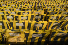Yellow and black concrete barriers Royalty Free Stock Photos