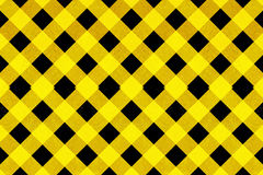 Yellow and black criss cross pattern Stock Image