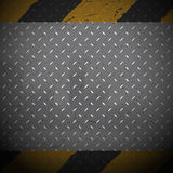 Yellow and black danger lines on metal background Stock Photography