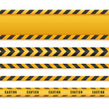 Yellow and black danger tapes. Caution lines isolated. Vector illustration. Yellow and black danger tapes. Caution lines isolated on white. Vector illustration Stock Image