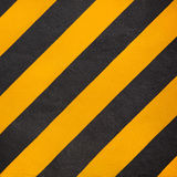 Yellow and black diagonal stripe warning Stock Photos