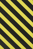 Yellow and black diagonal stripes Stock Images