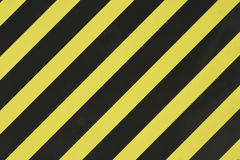 Yellow and black diagonal stripes Stock Photo